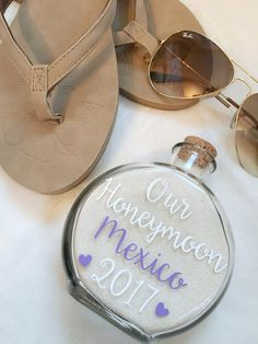 "Bring home a piece of your honeymoon with this customizable sand keepsake and remember your honeymoon for years to come! SPECS: Glass holder Cork stopper Measures 4.75 inches in height and 3.25 inches wide ♥HOW TO ORDER:♥ In the ""Notes to Seller"" at checkout please provide the"