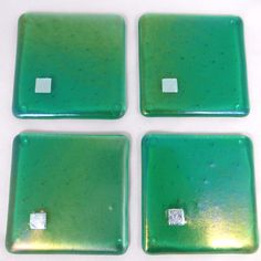 Emerald green iridescent fused glass coasters with silver metallic dichroic glass detail