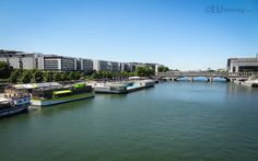 This photo shows the wide River Seine with unique moored up boats along the bank which can vary from nightclubs through to a seasonal floating swimming pool.  Daily updates at www.eutouring.com/images_river_seine.html