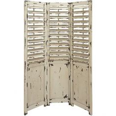 """Three-panel antiqued room divider with louvered panels.Product: Room divider  Construction Material: Wood  Color: Distressed ivory    Dimensions: 72"""" H x 48"""" W (overall)        Cleaning and Care: Wipe with dry cloth"""