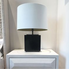New to our signature collection this is an elegant marble table lamp with bronzed detailing. The structure of the lamp is made from black marble with a bronzed plinth on the top and bottom of the lamp. Also available in white or grey marble.