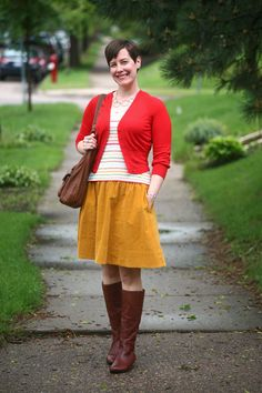 Already Pretty outfit featuring cropped red cardigan, striped tank top, mustard skirt, flat cognac boots