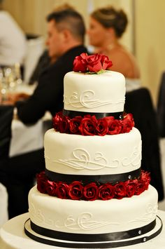 Traditional three tiered wedding cake with touches of Red and Black. Charnell Timms Photography
