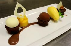 Sweeten the end of your busy week with chocolate tart with trio of ganache and mango sorbet!