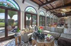 Beautiful stained glass windows and mahogany framed doors open out to sweeping golf course views at this home in Coral Gables.  Read more about Coral Gables homes at http://coralgablesrealestatevault.com.  #coralgables