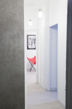 Interior design - entrance hall - concrete wall - butterfly chair & Marimekko Fabric - Design by See and Feel Spatial Design, Helsinki, Finland