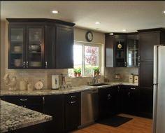Tumbled marble subway tile backsplash, dark cabinets, light countertops, perfect!