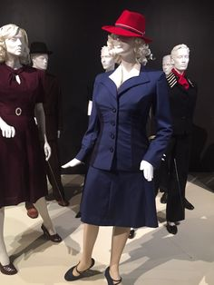 Peggy's blue suit on display at the FIDM, flanked by the plum dress and Dottie's suit. Photo by ralkana on Tumblr.