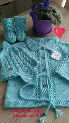 Free Knitting Pattern for Baby CardigansFree baby knitting pattern set including a lace cardigan and booties. Baby Sweater Patterns, Baby Knitting Patterns, Baby Patterns, Cardigan Bebe, Baby Cardigan, Crochet Baby Sweaters, Baby Coat, Knitting For Kids, Baby Dress