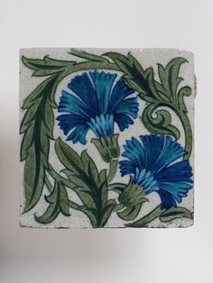 Tile        Place of origin:        London, England (made)      Date:        ca. 1885 (made)      Artist/Maker:        De Morgan, William Frend, born 1839 - died 1917 (maker)      Materials and Techniques:        Earthenware painted in enamel colours