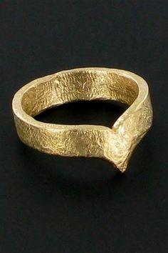 Anneau de sexe en bronze : à la fois cockring et bijou