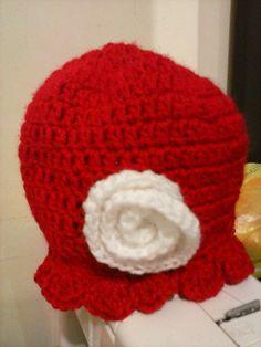 boina vermelha com flor