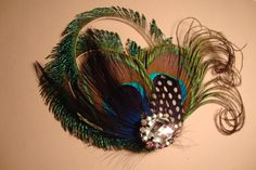 Purely PeacockFeather Hair ClipFascinator by GirlCandyDesigns, $27.95. We could SOOO make these Jolee ;)