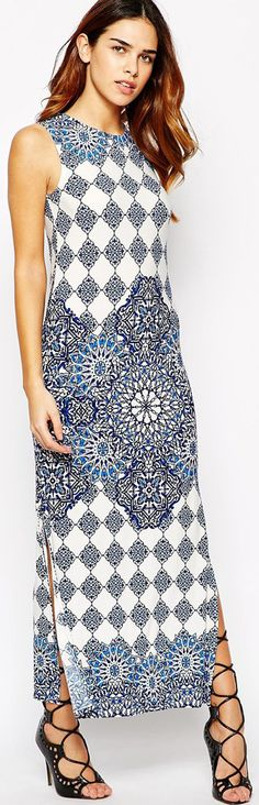 I love this fantasy tile print maxi. This proves that a blue and white print does NOT have to be boring - read tips - http://www.boomerinas.com/2015/05/14/moroccan-tile-print-maxi-dresses-tunics-for-women-over-40-50-60/