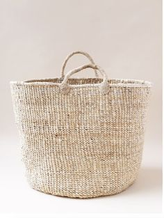 Indego Africa's handmade, woven floor baskets from locally-sourced, natural materials. Perfect for any living room, playroom, or home organization. Diy Basket, Basket Bag, Handbag Storage, Wicker Baskets, Woven Baskets, Basket Weaving, Straw Bag, Knitting, Leather