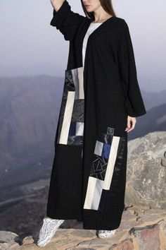 Black open-style Abaya featuring a patch pattern detail with front pocket. Niqab Fashion, Modest Fashion Hijab, African Fashion Dresses, Muslim Fashion, Kaftan Style, Mode Abaya, Abaya Designs, Clothing Photography, Wedding Bride