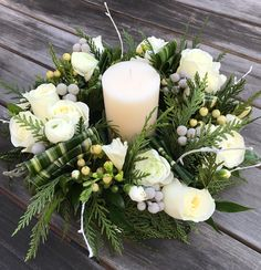 Holiday fresh flower table wreath with winter greens, berries, roses, with a candle in the center. Christmas Flower Arrangements, Christmas Flowers, Beautiful Flower Arrangements, Christmas Candles, Christmas Centerpieces, Flower Centerpieces, Simple Christmas, Floral Arrangements, Christmas Wreaths
