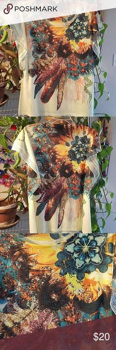 "Cap sleeved Top Beautiful cap sleeved Top has delicate embroidered lace on edge of sleeves,  gem detailed on front of this beauty.  The scoop neck and sleeves give a butterfly look that is stunning.  100% polyester  Bust 34"" Brand new never worn Excellent condition Energie Tops"
