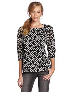 Trina Turk Women's Insley Blouse Trina Turk. $124.00. Elbow sleeves. Pleated shoulder detail. Dada Dot Georgette. Dry Clean Only. 93% Silk/7% Lycra