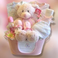 """""""Baby Girl Hugs"""" Welcome baby into the world with our charming Baby Girl Hugs gift basket. Our attractive pink re-usable metal container contains two patterned infant sleepers with matching hat and bib, infant booties, receiving blanket, baby teether and an adorable Baby's First Teddy by Russ."""