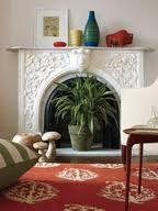 ways to decorate a filled in fireplace - Google Search