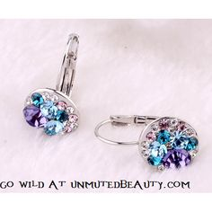 Purple Crystal Blast Earrings $24  Members at unmutedbeauty.com you know how it goes! Enter the code: addicted during check out to get the discount =D