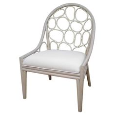 Hand-woven+rattan+side+chair+with+abstract+open+back+detail+and+a+whitewash+finish.++  Product:+ChairConstruction+Mat...