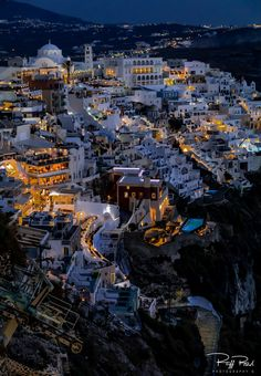 Fira, Santorini Evening Lights. - Fira, draped on the side of an old volcano.