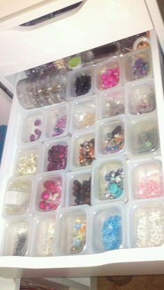 baby food containers in a drawer to organize my beading supplies