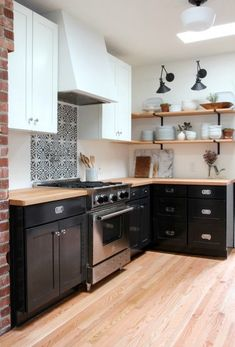 Wall mount lights Patterned tile accent Open shelves Butcherblock ctops