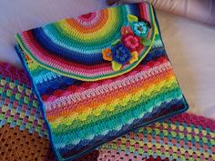 Crochet Rainbow Bag - free pattern tutorial with lots of photos and a stitch diagram. Originally a nightdress case with info on resizing for your tablets/kindle etc. From Oran at Misty Mountain.