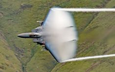 Talk about letting off steam! These incredible snaps show up-close photos of low flying jets as they zoom through the picturesque Welsh valleys, leaving fluffy trails of generated vapour cloud in their wake. The amazing jets were snapped by freelance photographer Bob Sharples, a retired Royal Navy aircraft weapons electrician, in Snowdonia, Wales. The eager aviation photographer spent an hour trekking up a steep, rocky hill carrying heavy camera gear and supplies to make sure he got the…