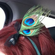 I made this clip for my hair with peacock feathers. Turned out pretty good