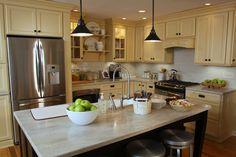 Martha Stewart Kitchen w/ cabinets in 'Fortune Cookie' paint and 'Shoreline' Corian countertops.