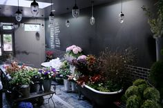 I love the chalkboard wall idea and the tub to hold masses of flowers...I used the study carrell chalkboard when designing my bouquets for my finals. :)