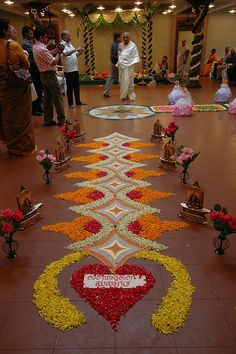 Rangoli - this is a flower rangoli, for the saptapadi ritual of a south indian wedding. so different!!