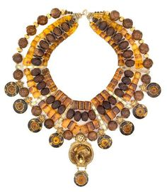 Tony Duquette (American, 1914-1999), 'Symbolizing Wealth and Success DESPITE All Odds', 1990s. tortoisehell A mock antique, amber, garnet, seed, wood and vermeil necklace with vintage Japanese netsuke pendant, signed Tony Duquette, with original box , length 19in (48.2cm). Sold for $ 9.150