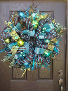 LAVISH PEACOCK Mesh Wreath by GlitzyWreaths on Etsy, $135.00 I like that this one has some brown in it so it's not quite so overwhelmingly blue...