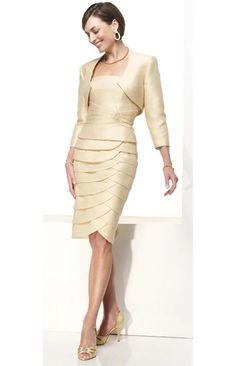 Short mother of the bride dresses with a long sleeve jacket are available. This pastel cream colored cocktail dress has a tiered skirt. This could be made long when recreated new. See other short mother of the bride dresses with a jacket at www.dariuscordell.com