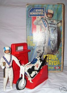 Evil Knievel and his stunt cycle. We all would make Evil do amazing stunts (ie. jumping across huge puddles or off of the porch)!