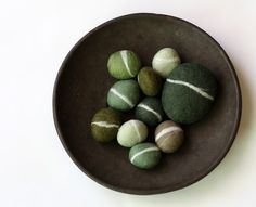 I love collecting actual rocks with rings like these. Good luck of course! Green Felted Pebble Gift Set by delica on Etsy, $36.00