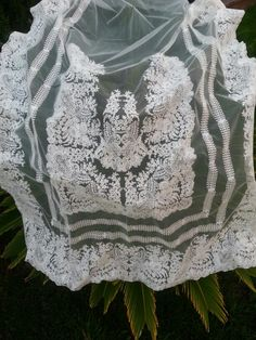 Www.facebook.com/adrilucsl. ..we don't have words for that last design we create with the name of Alejandra all embroidery cotton on tulle net ivoire cotton.Then we ll do the lace and mantilla also