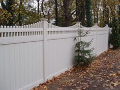 "The Illinois Style vinyl fence has the look of a privacy PVC Fence with a closed top Victorian picket! This fence is constructed out of a 2"" x 7"" Heavy duty mid and bottom u-channel rails."
