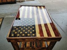American flag wood coffee table Epoxy clear finish The wood is Pine torched to bring out wood 2620 tall options in colors Red and blue Faded Glory Thin Blue Line. American Flag Wood, American Flag Decor, Into The Woods, Diy Holz, Deco Design, Wood Design, Pallet Furniture, Outdoor Furniture, Studio Furniture