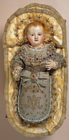 Maria Bambina    A baroque clothed statue from Southern Italy of Mary as a baby.