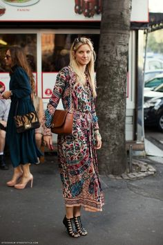 Long patterned dress, dressed up with bag and heels