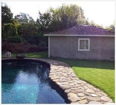 A cobblestone deck gives your pool area a natural allure.