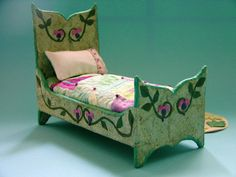 tiny doll bed | Flickr - Photo Sharing! Another little doll bed that I designed and created for a five inch doll using paper mache and decoupage techniques. I made the little quilt with fabric that I hand dyed.