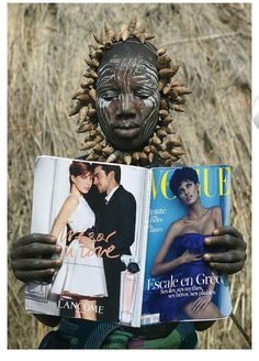 Woman from Ethiopia reads new Ethiopian Vouge