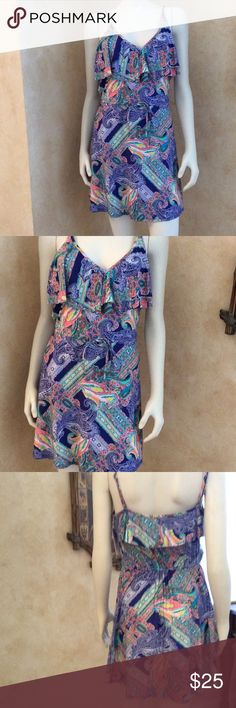 Kenneth Cole reaction swimsuit cover up Nwt Kenneth Cole reaction swimsuit cover up dress size large. Paisley print ruffle v-neckline  with drawstring waist. 85% nylon 15% elastane. Never worn. Kenneth Cole Reaction Swim Coverups